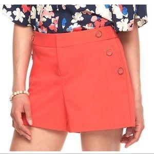 NWT. Elle Orange Shorts. Size 6.